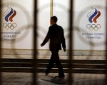 A man walks in front of the Russian Olympic Committee headquarters building, which also houses the management of Russian Athletics Federation in Moscow